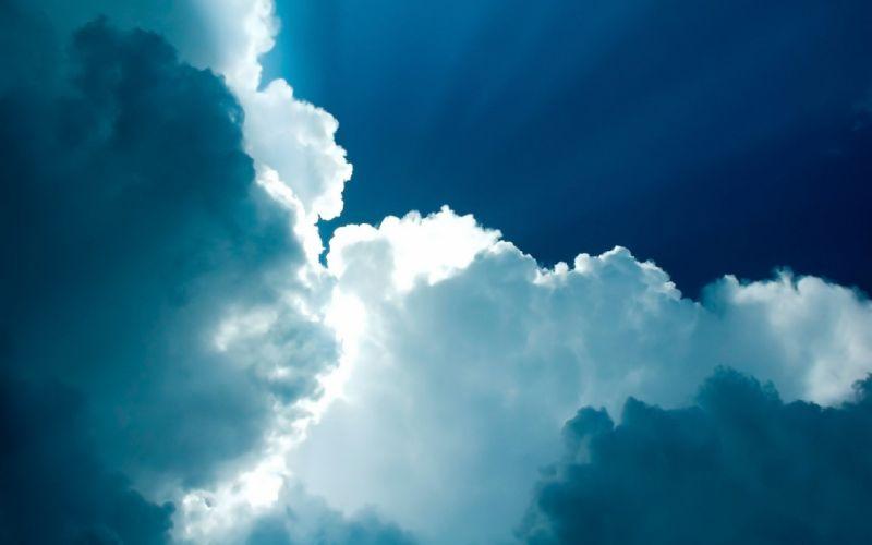 White clouds in a blue sky wallpaper