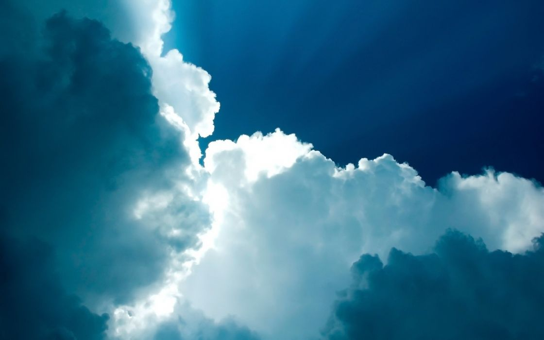 White clouds in a blue sky wallpaper