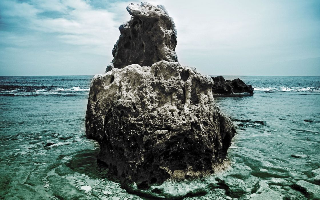 Big rock over spain beach wallpaper