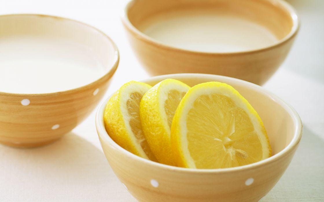 Bowl with lemon slices wallpaper