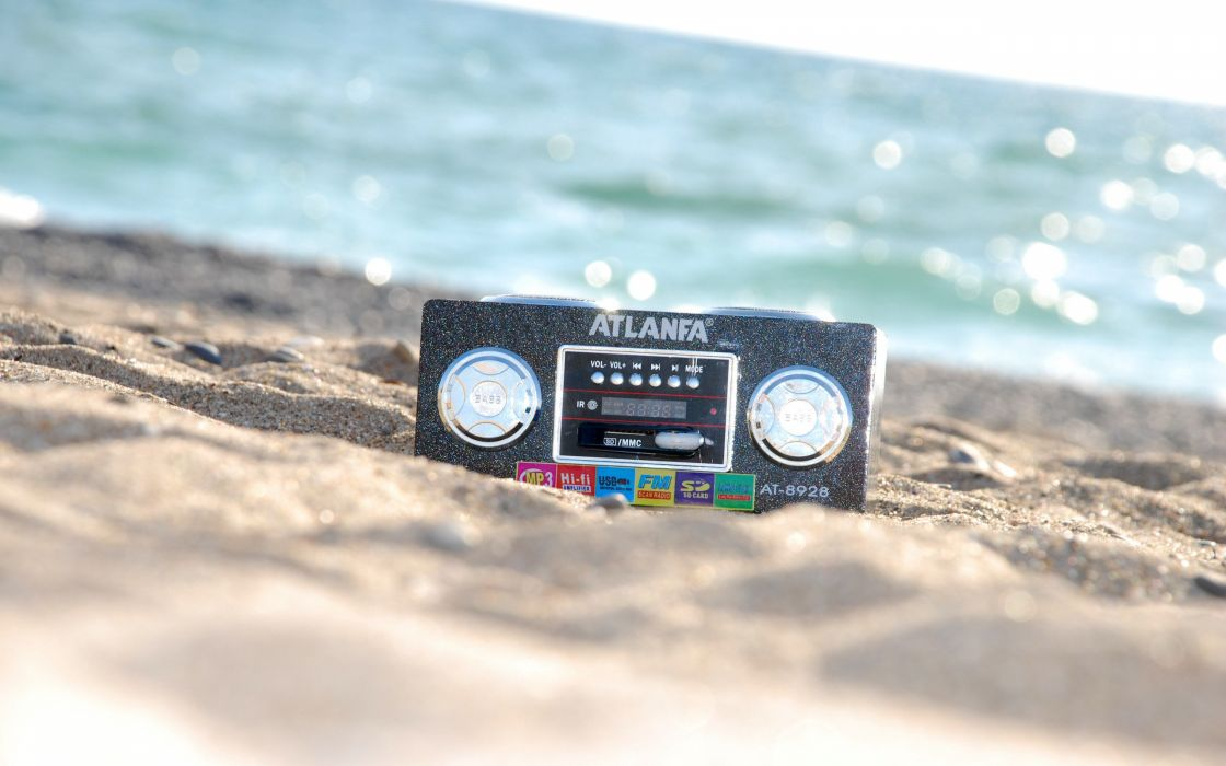 Old style stereo on the sand wallpaper