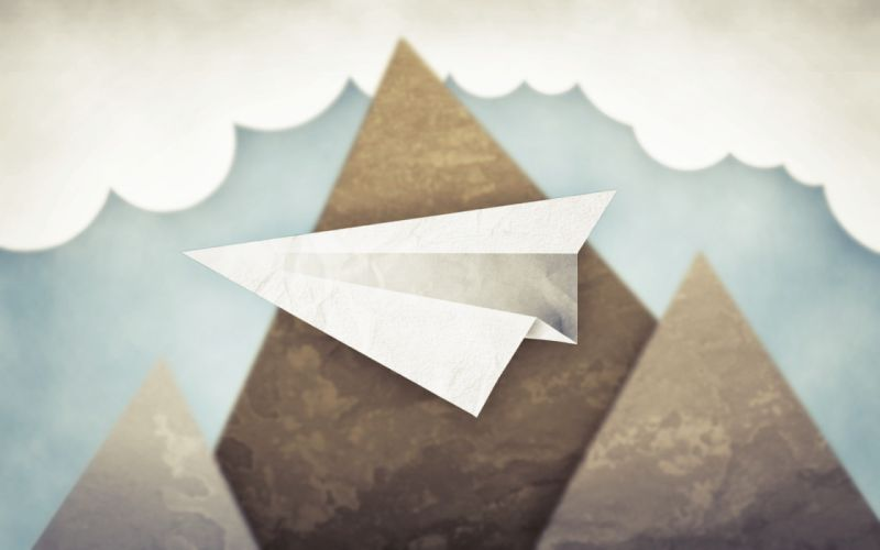 Flying paper airplane wallpaper