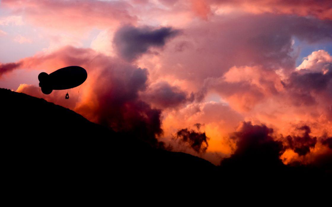 Airship at sunset wallpaper
