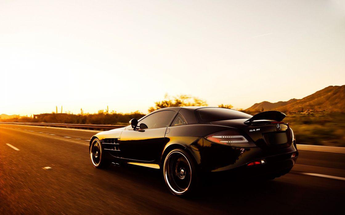 Black Mercedes SLR driving on the road wallpaper