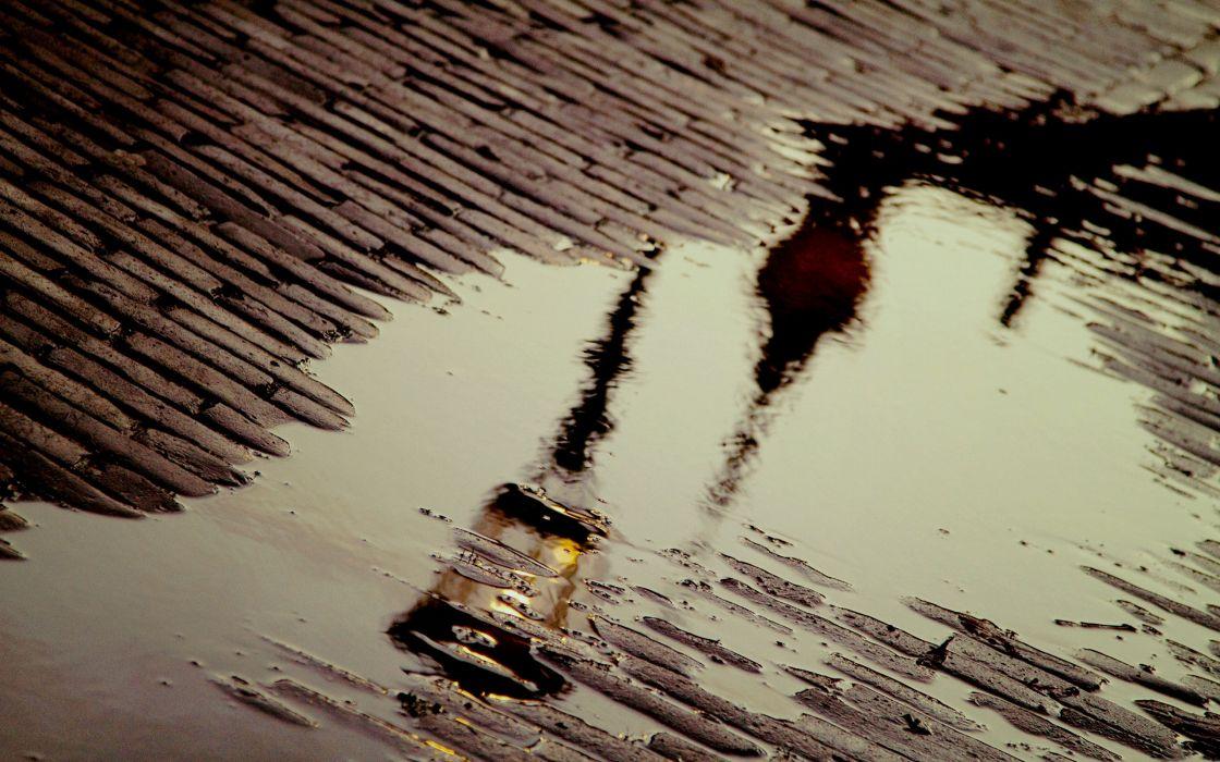 Rain over cobblestones wallpaper