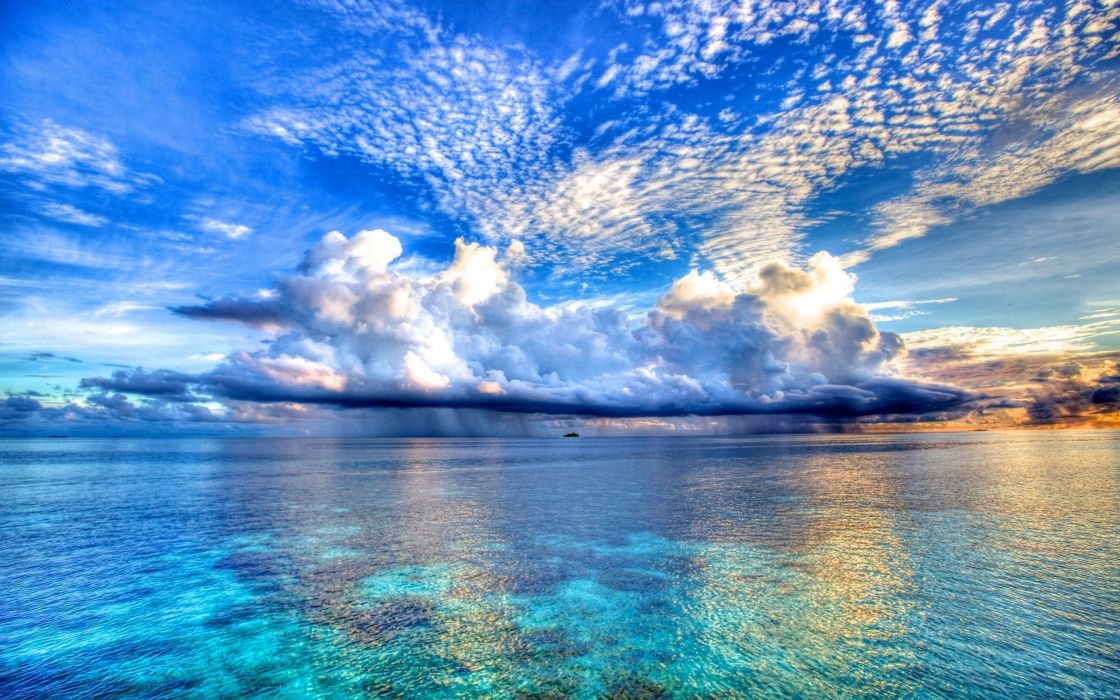 Clouds over the sea wallpaper