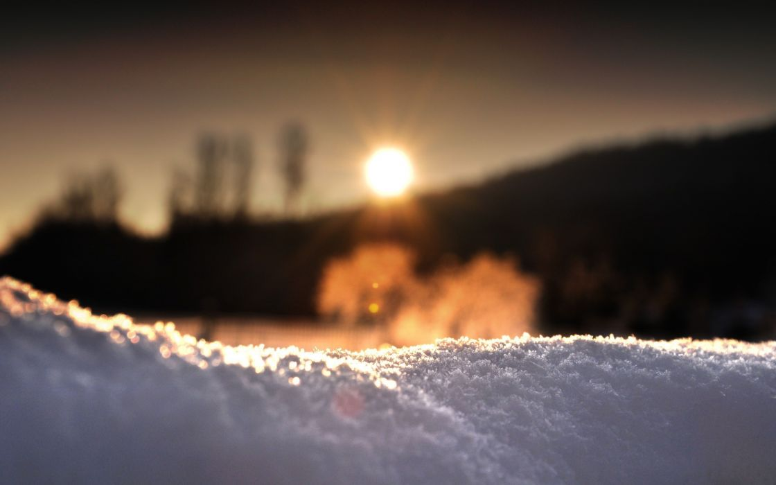 Sunrise behind the snow wallpaper