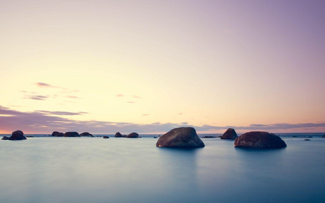 Standing rocks in water wallpaper