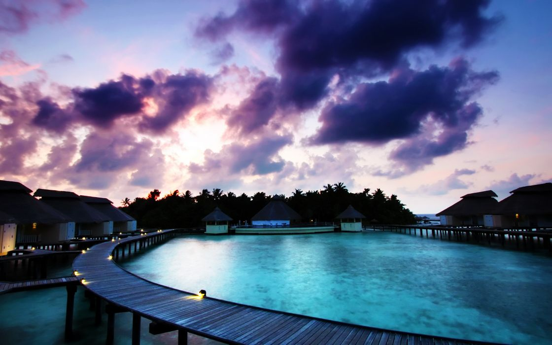 Maldivian sunrise over the tourist cottages wallpaper