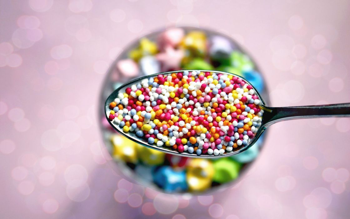 Spoon with colored pills wallpaper