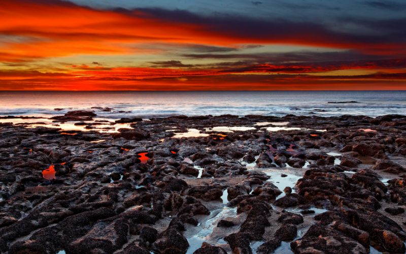 Flaming view from the beach wallpaper