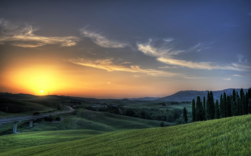 Rising up sun behind the hills wallpaper