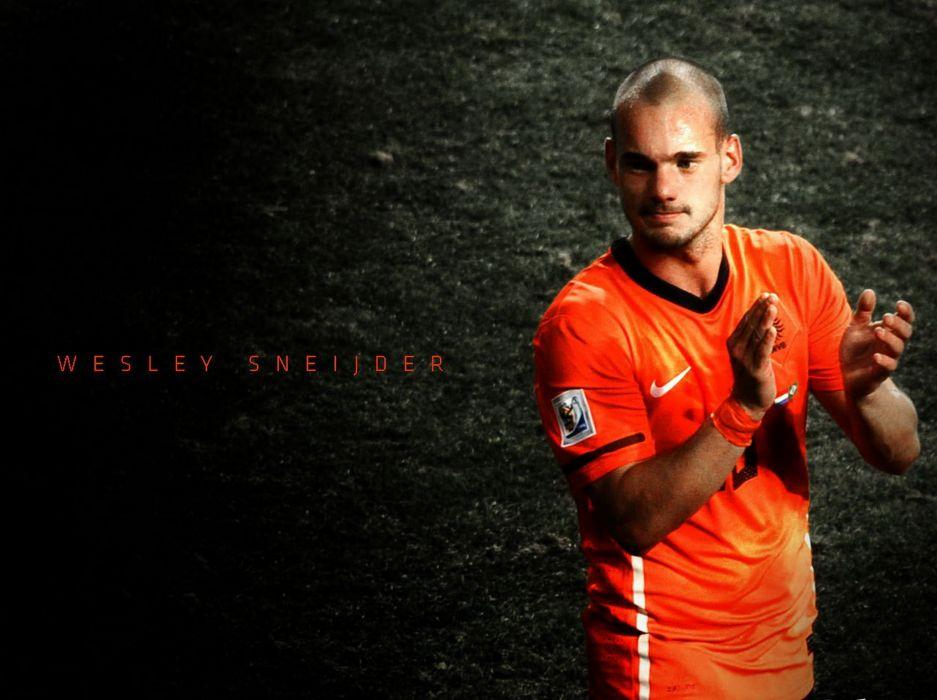 Wesley Sneijder with Orange wallpaper