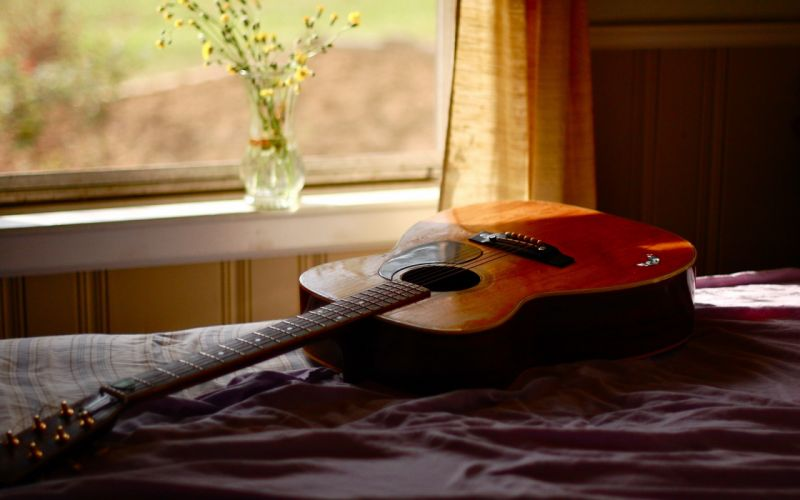 Guitar on the bed wallpaper