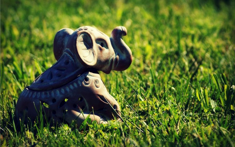 Indian elephant toy in the grass wallpaper