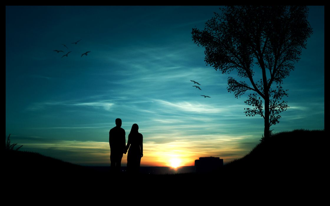 Couple at sunrise wallpaper