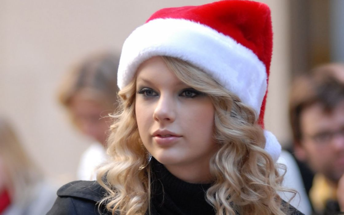 Taylor Swift with a christmas hat wallpaper