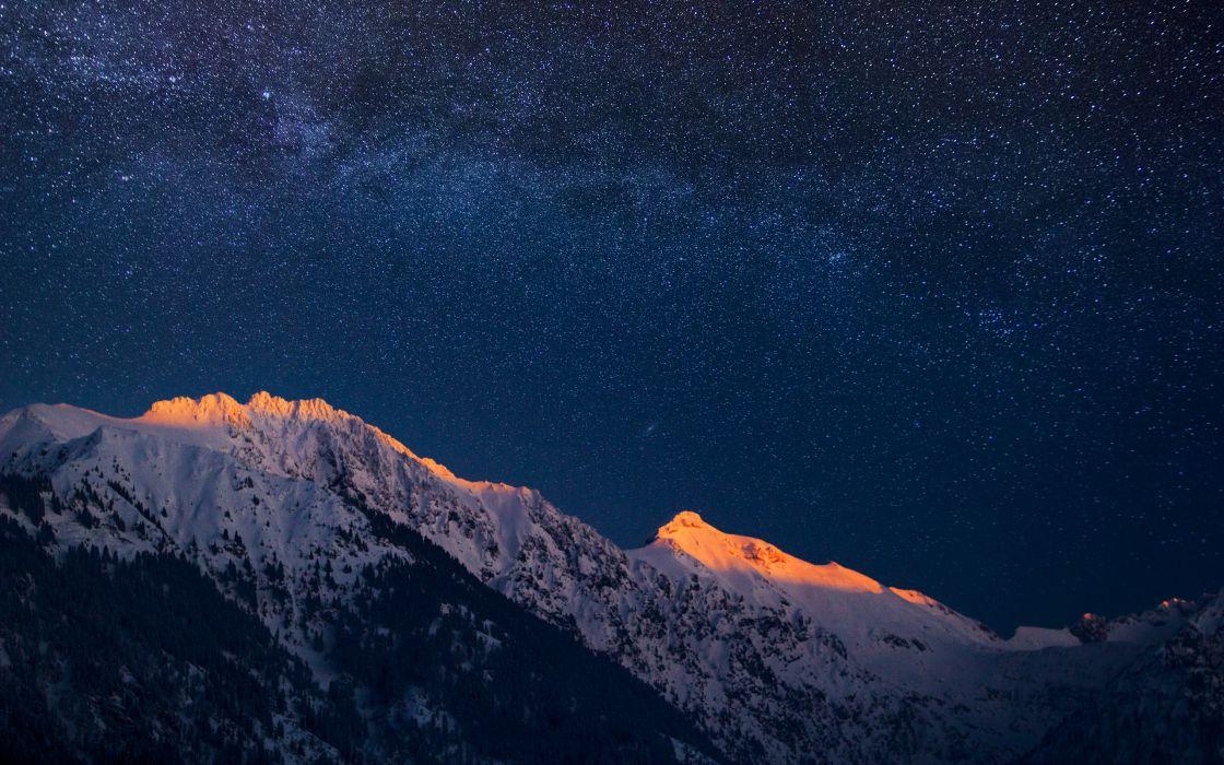 Glowing alps under Milky Way wallpaper