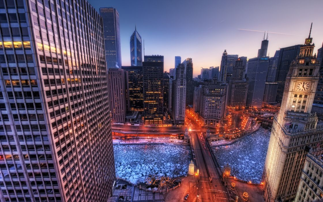 Frozen river into the city wallpaper