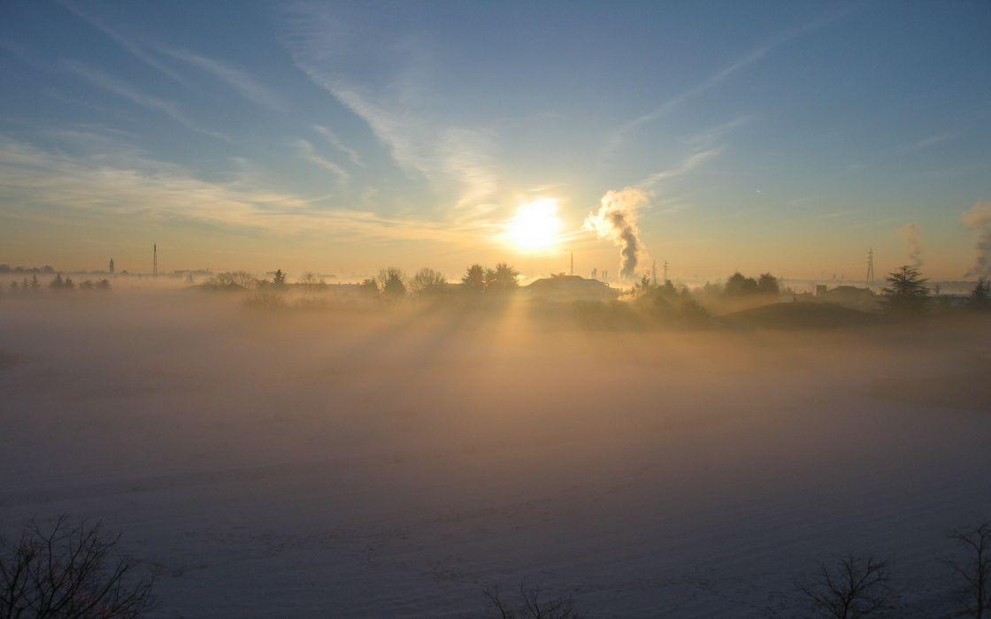Sunset behind winter fog wallpaper