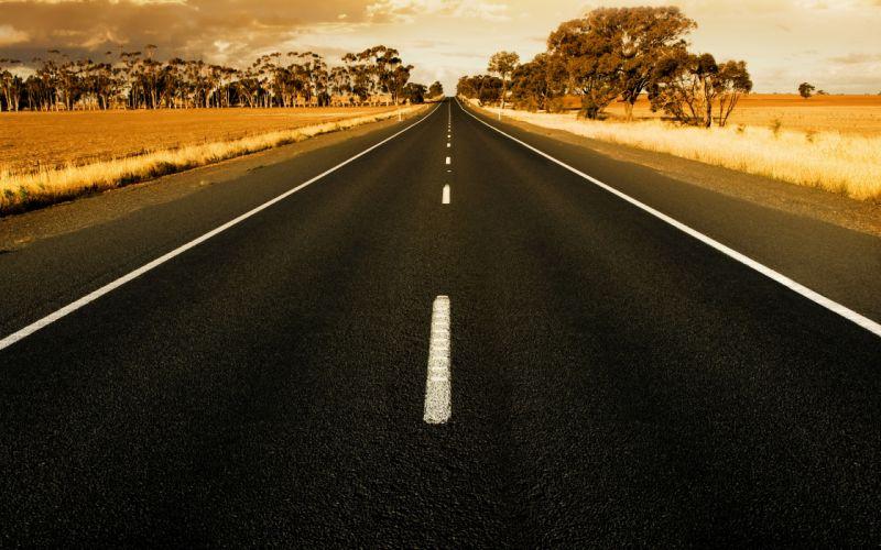 Straight road at sunset in rural australia wallpaper