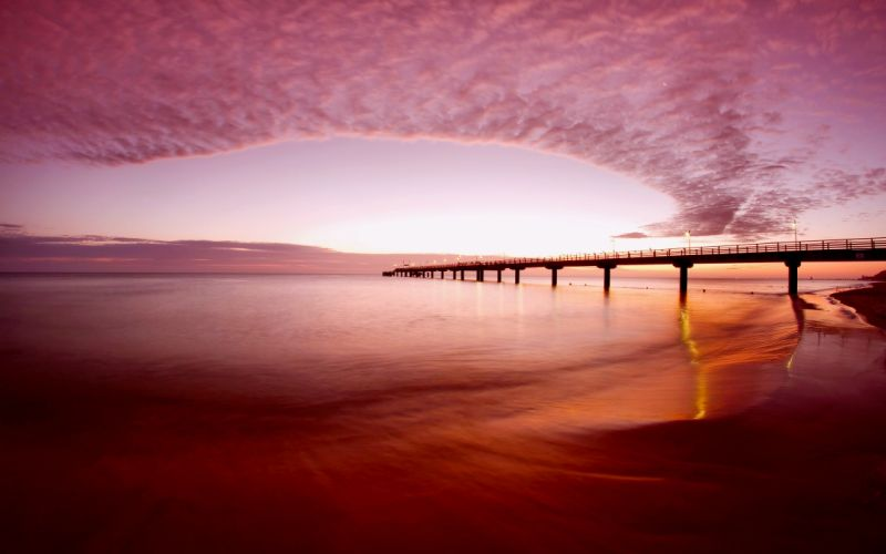Pink sky over the beach wallpaper