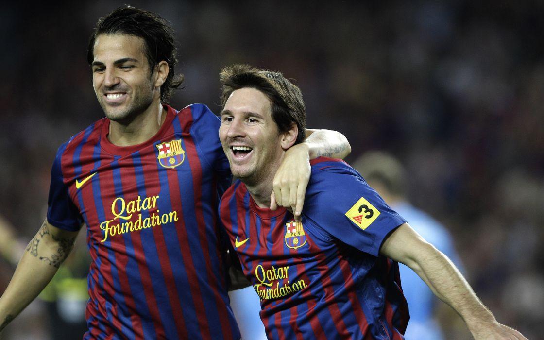 Cesc Fabregas And Lionel Messi wallpaper