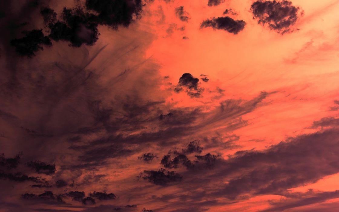 Dark orange clouds at sunset wallpaper