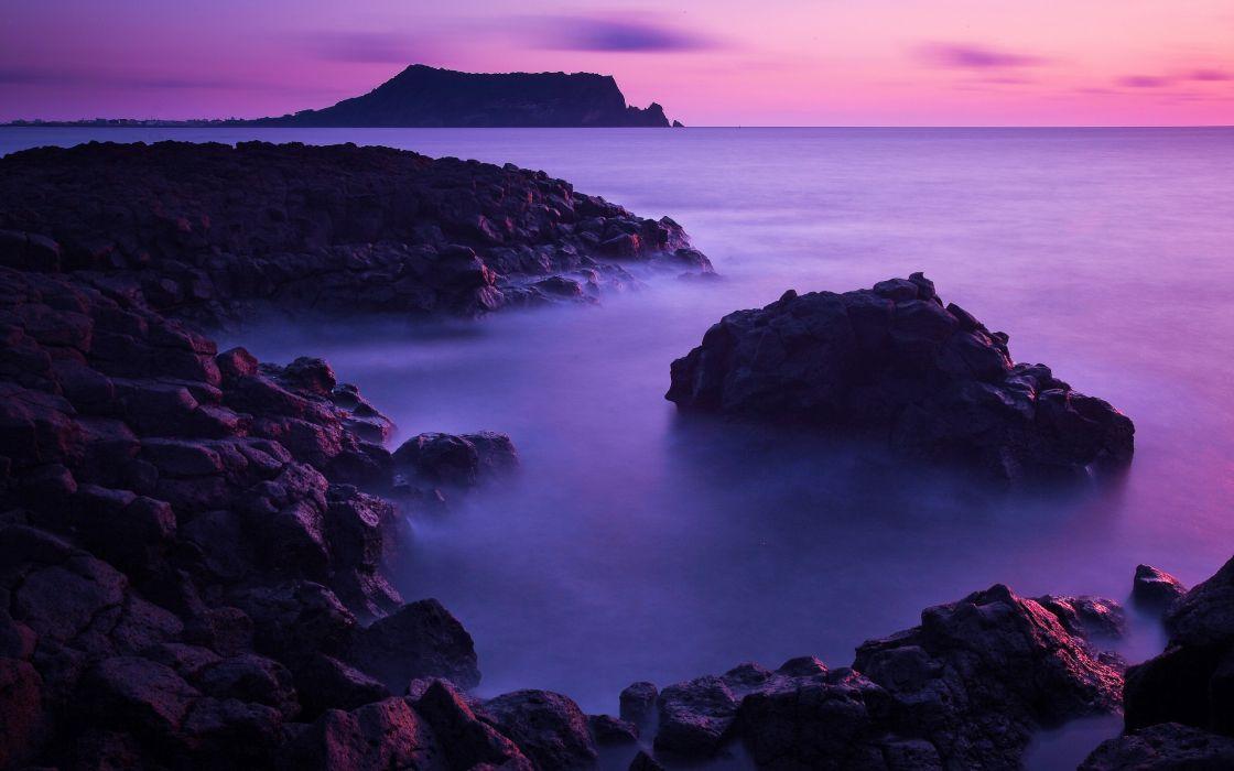 Misty purple shore wallpaper