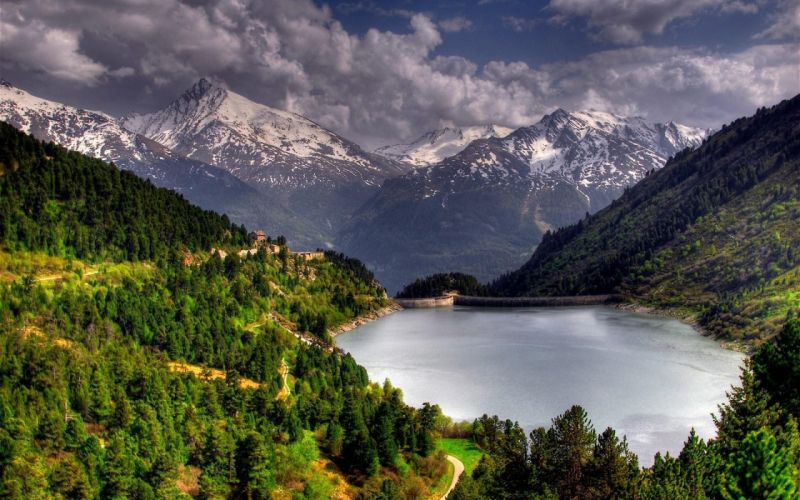 Green mountain and snowy mountain and dam wallpaper