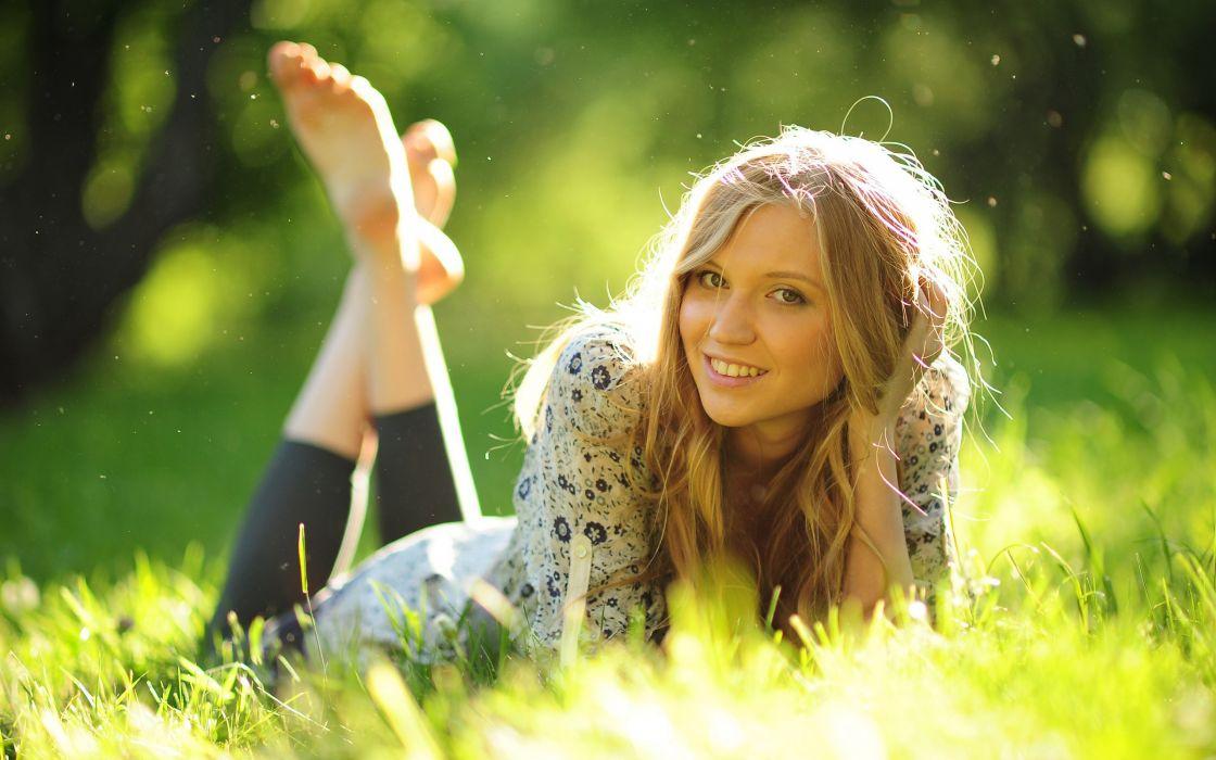 Girl lying on grass wallpaper