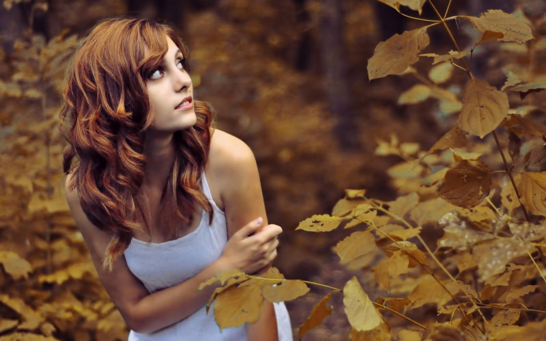 Girl in autumn forest wallpaper