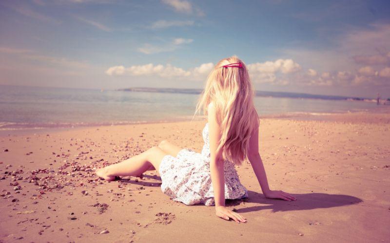 Blonde girl on the beach wallpaper