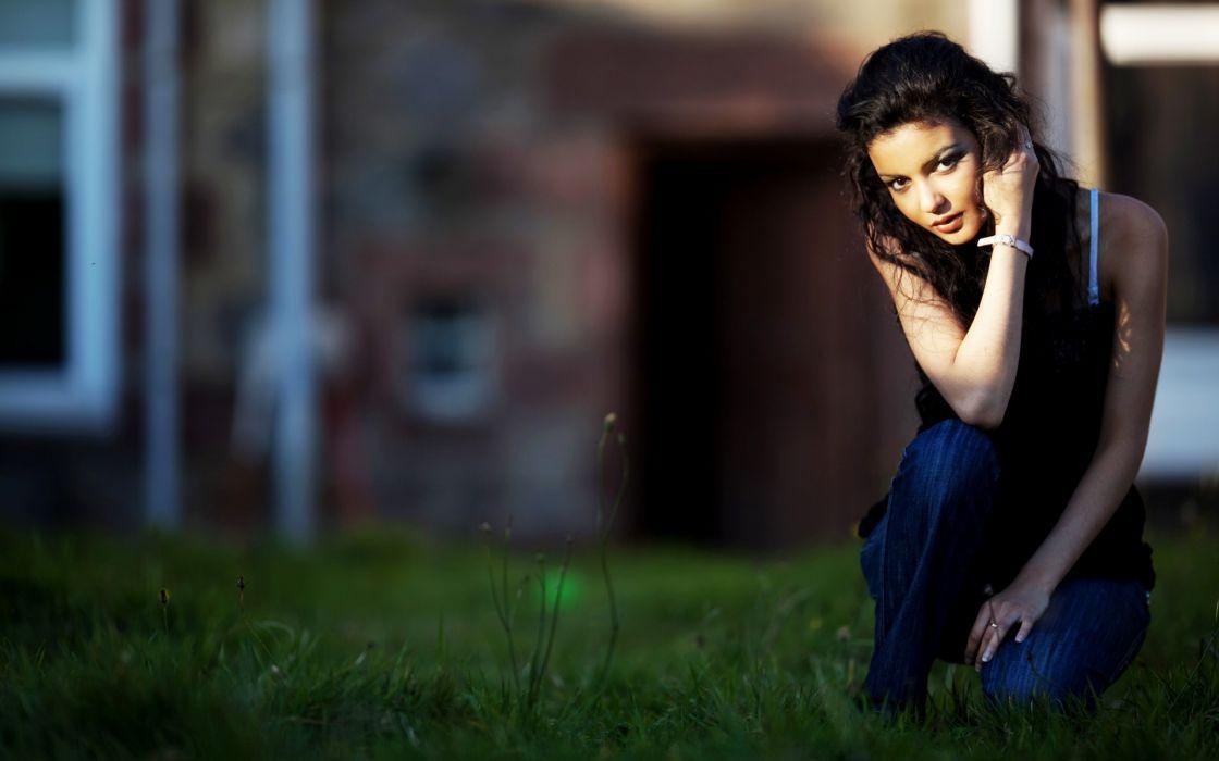 Girl sitting outside in grass wallpaper