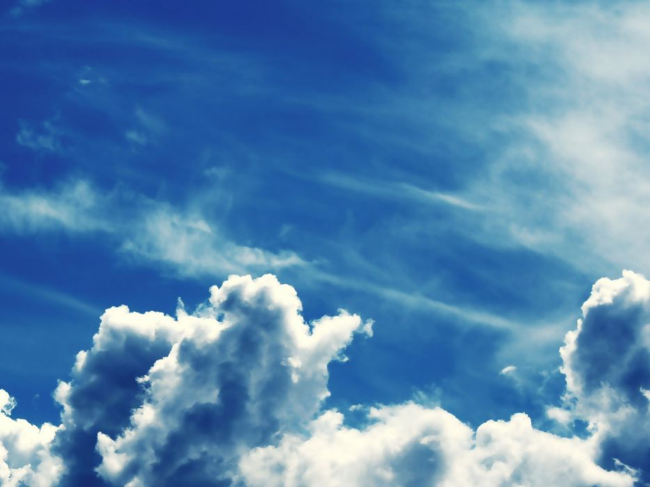 Bright Blue Sky with Fluffy Clouds wallpaper
