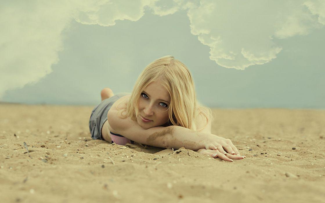 Blonde girl on a beach wallpaper