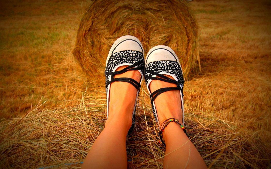 Girl sitting on hay bale wallpaper