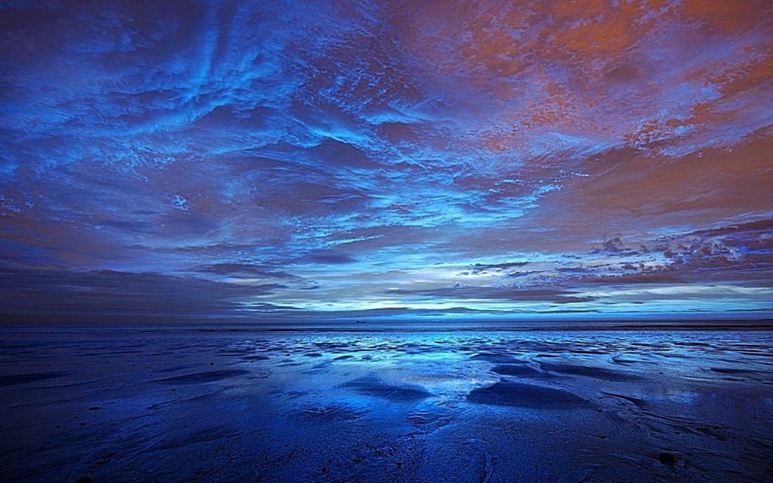 Dawn over beach wallpaper