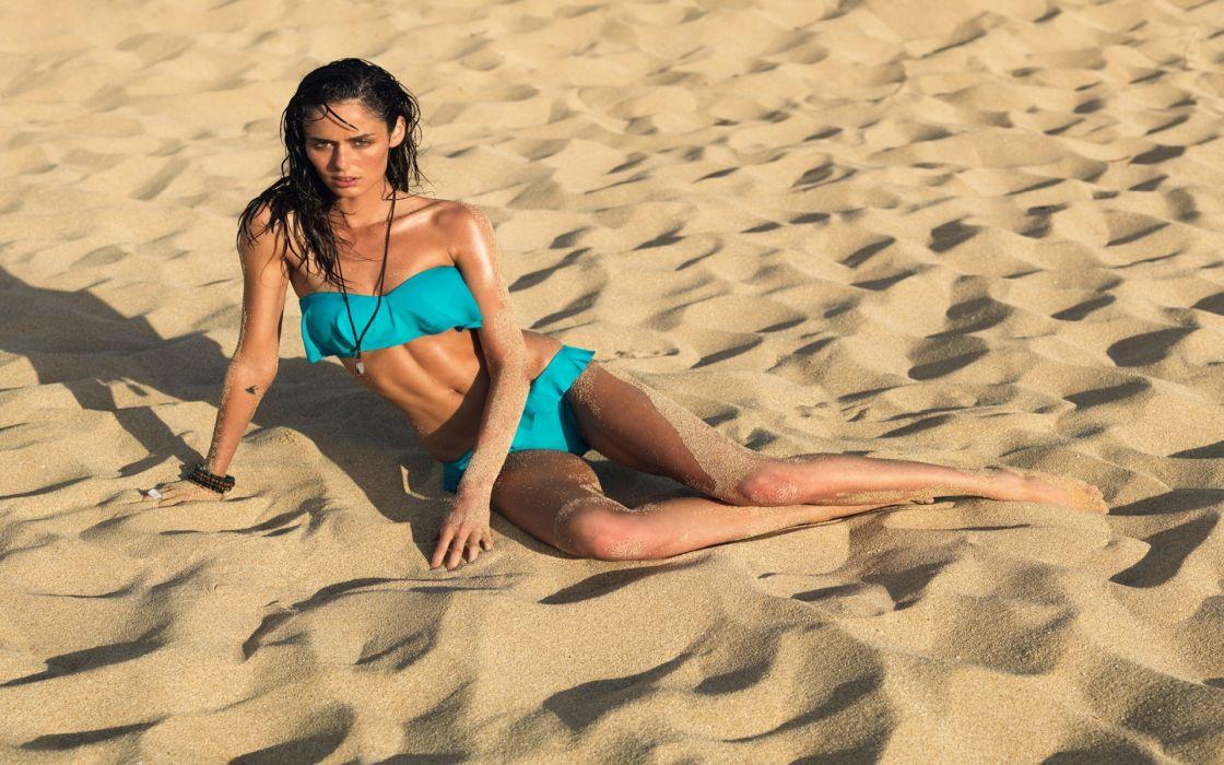 Nicole trunfio sitting on sand wallpaper