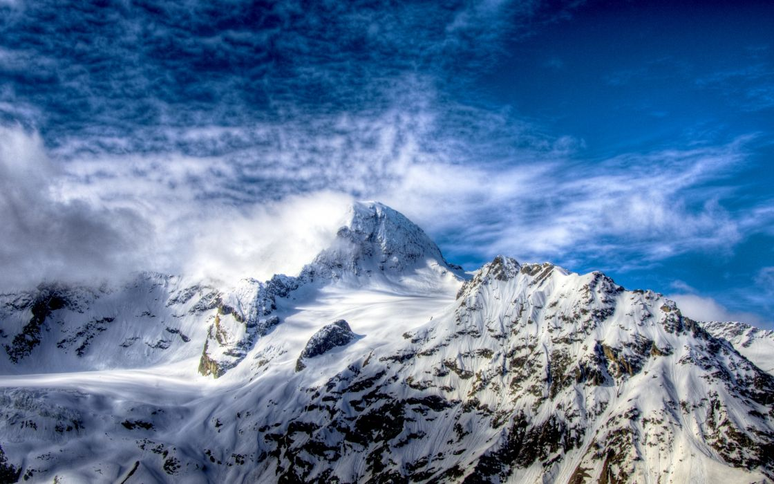 Snow on the mountains wallpaper