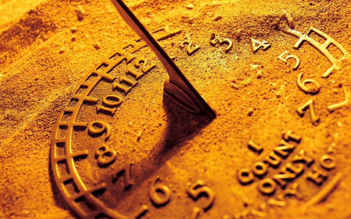 Golden sand watch wallpaper