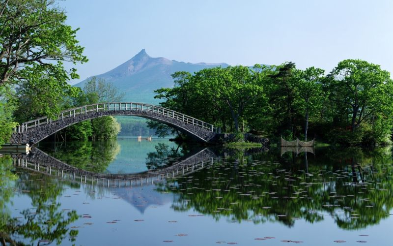 Old bridge over river wallpaper