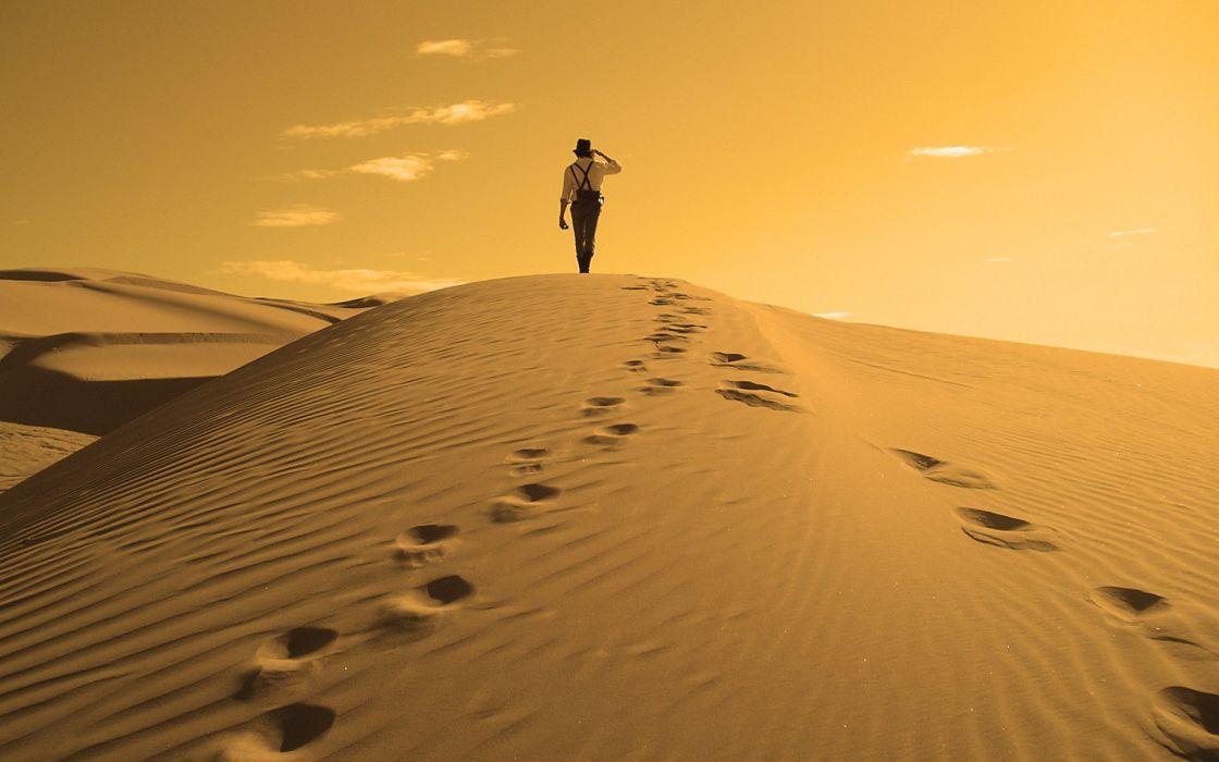 Man in desert wallpaper