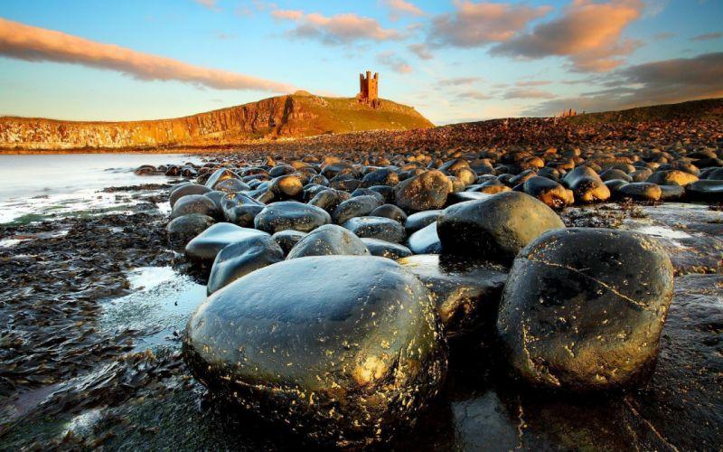 Black stones on the shore wallpaper