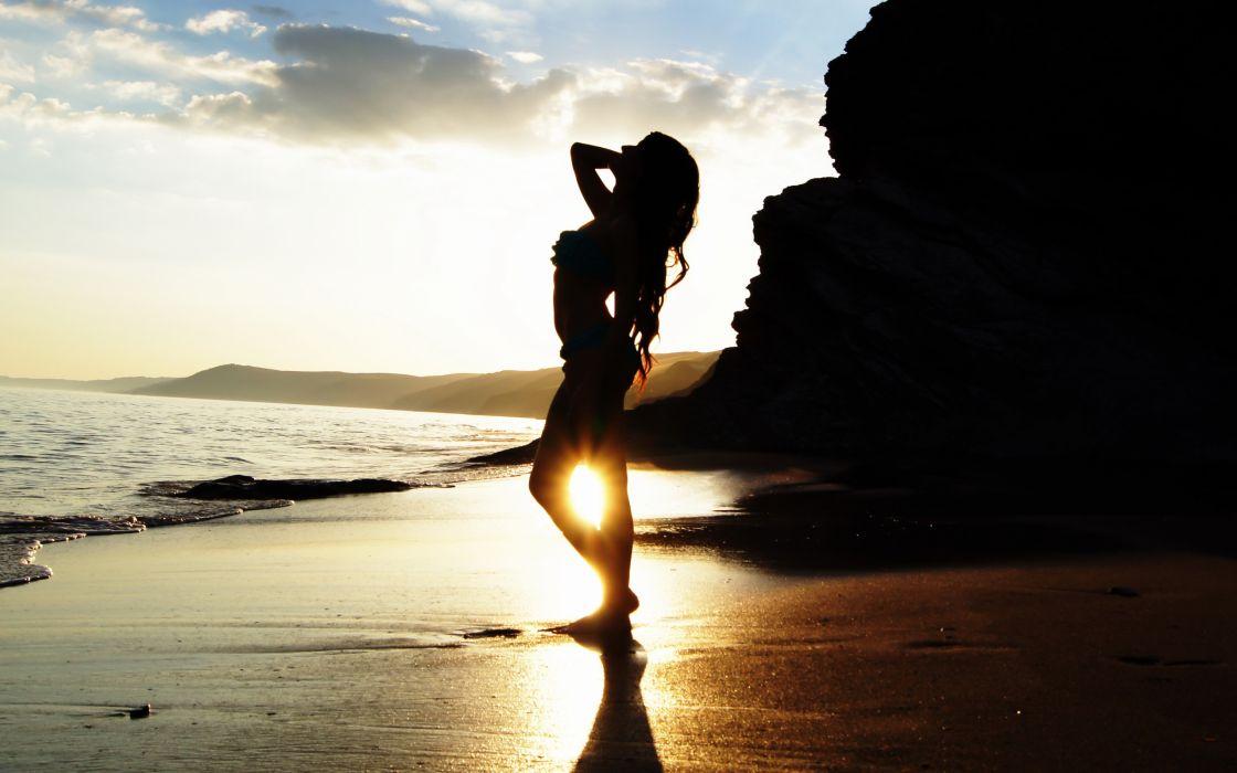 Sexy girl at sunset beach wallpaper