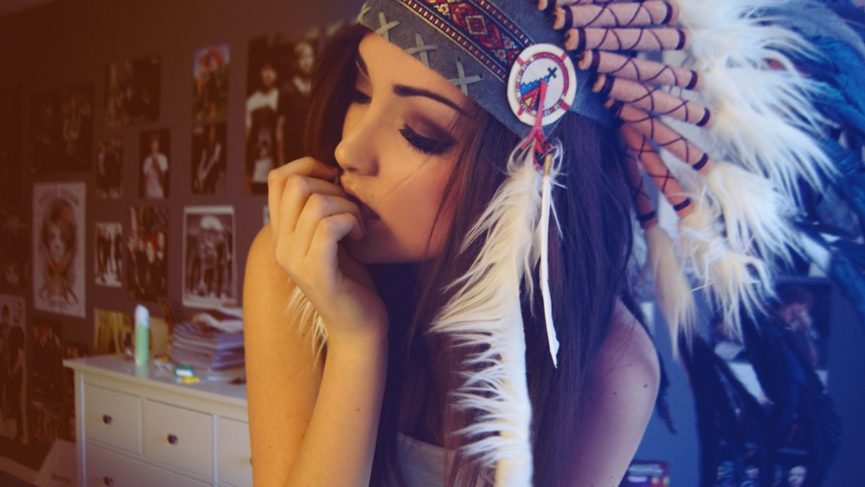 Girl wearing red indian colorful feathers hat wallpaper
