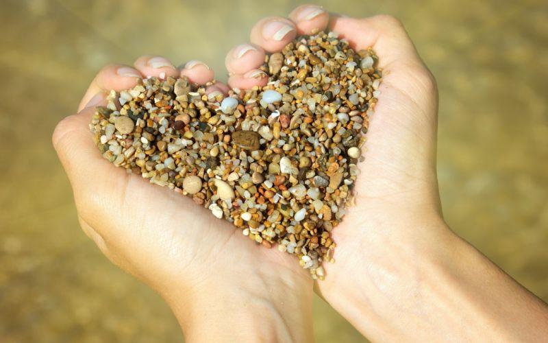 Hands stones hearts pebbles depth of field wallpaper