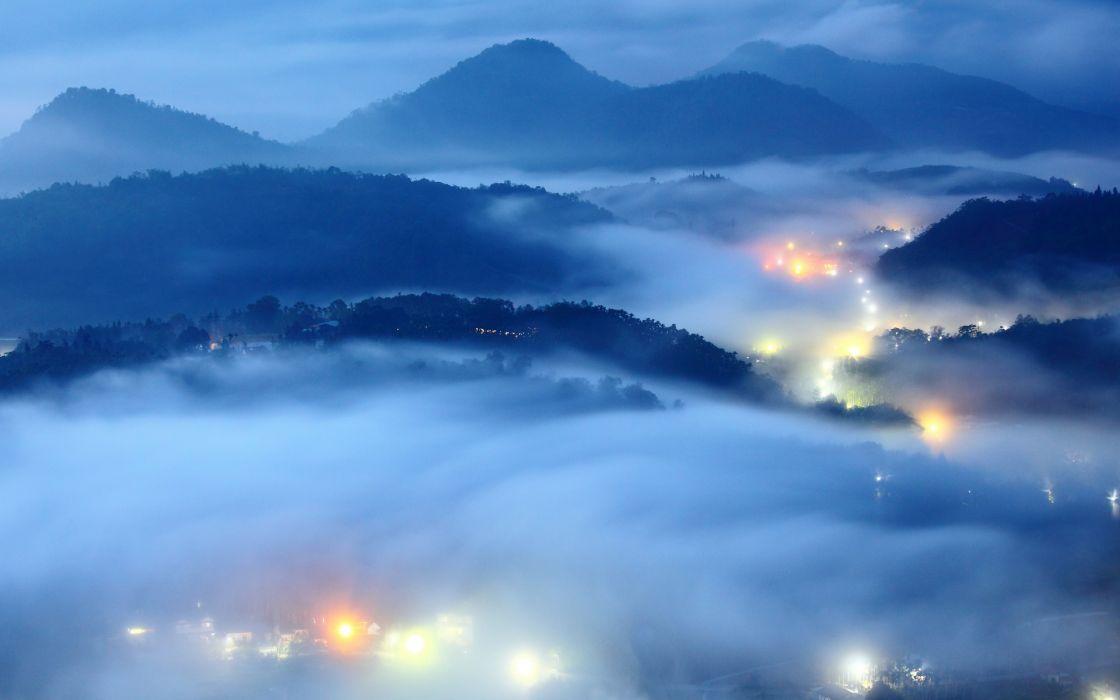 Blue landscapes hills mist citylights wallpaper