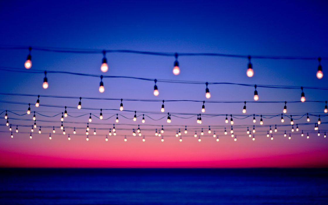 Sunset bokeh power lines light bulbs seascapes wallpaper