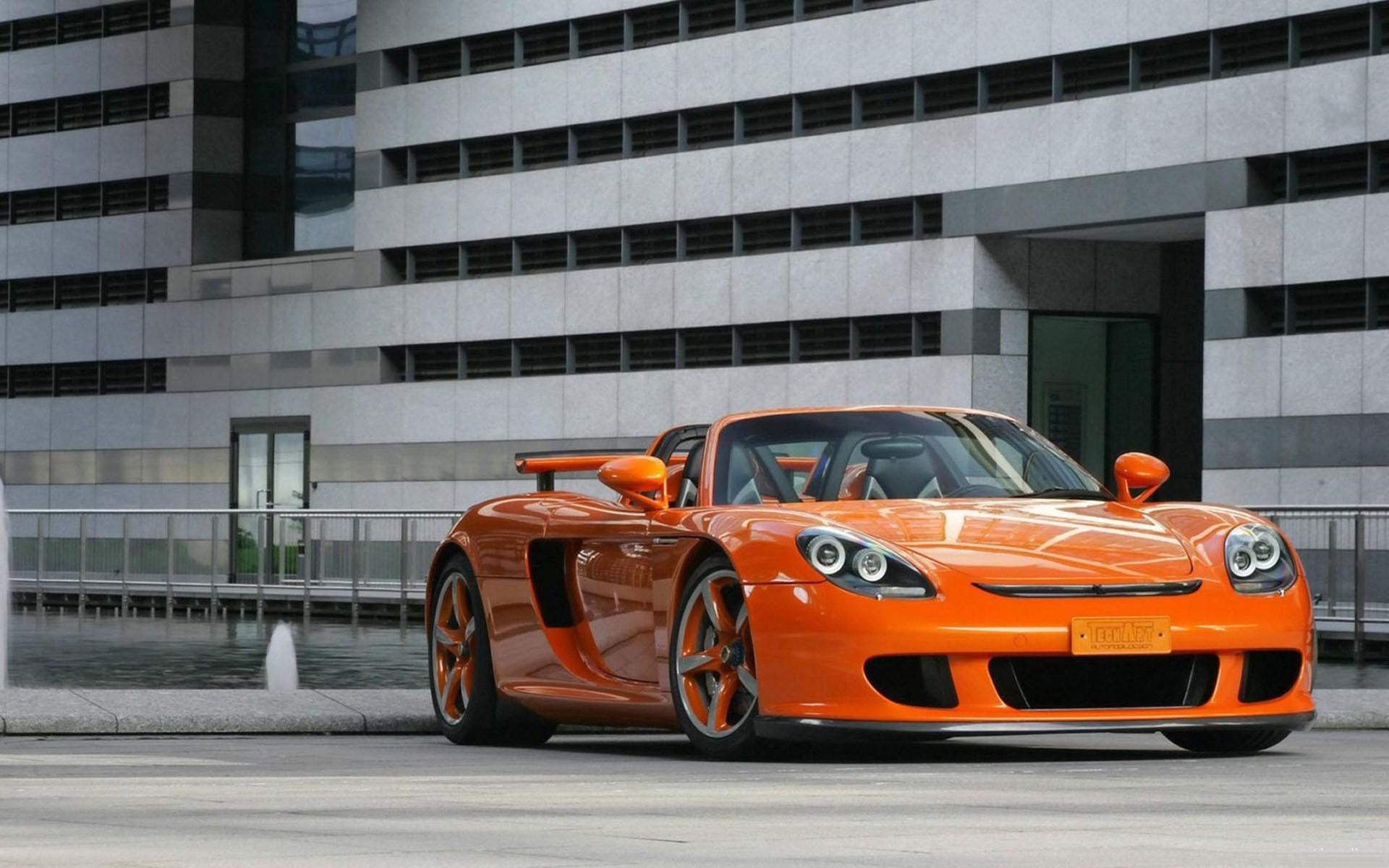 Оранжевый автомобиль porsche carrera  № 836991 без смс